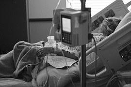 Patient in hospital bed_1460751313112.jpg