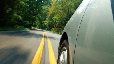 green-hybrid-car-driving-down-road-jpg_20151209141710-159532