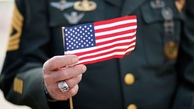 Veteran-holding-American-flag--Veterans-Day_20161111160548-159532