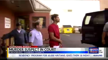 murder suspect in court_1511269170312.png