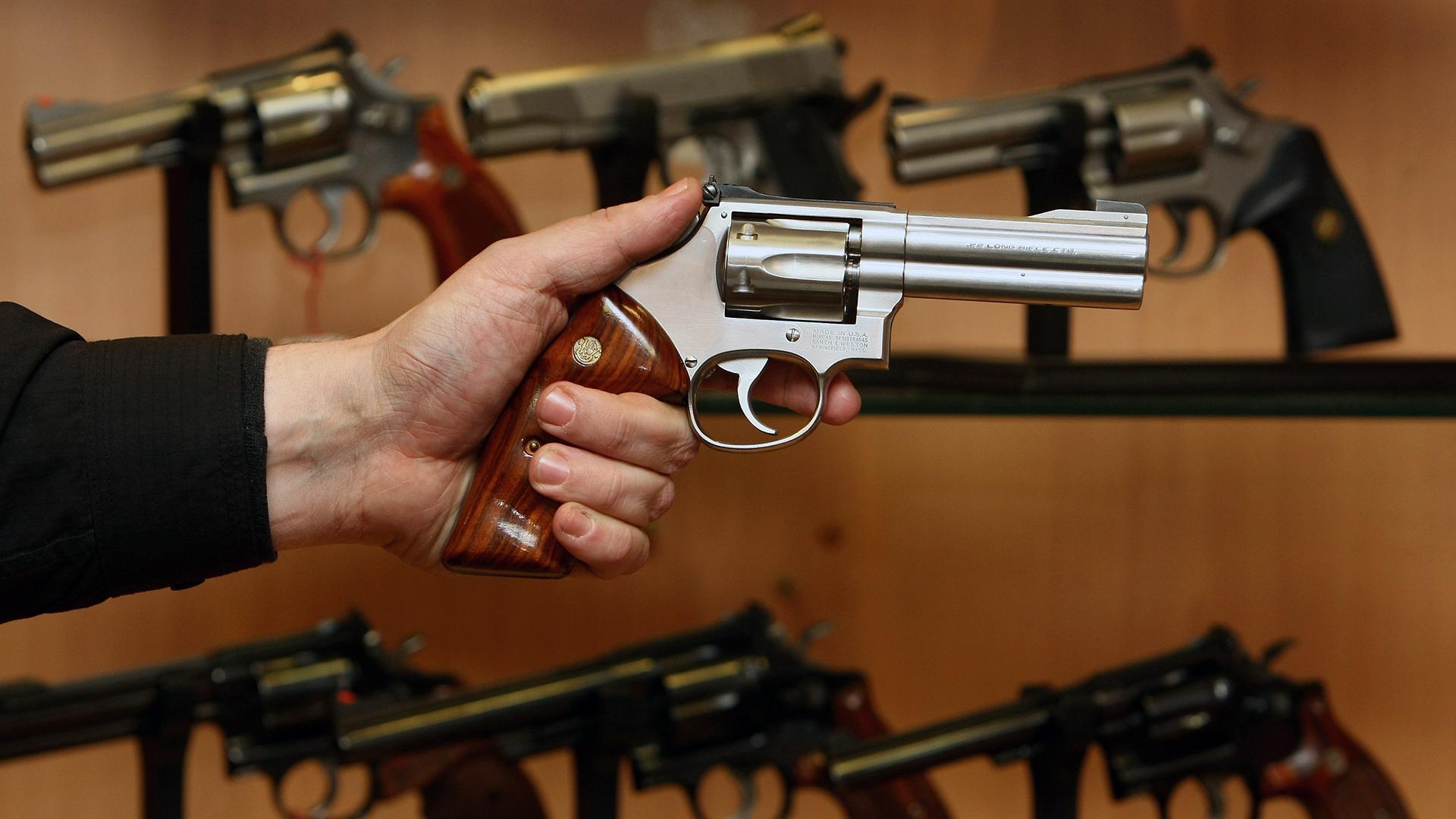 Smith & Wesson revolver gun held-159532.jpg25353922