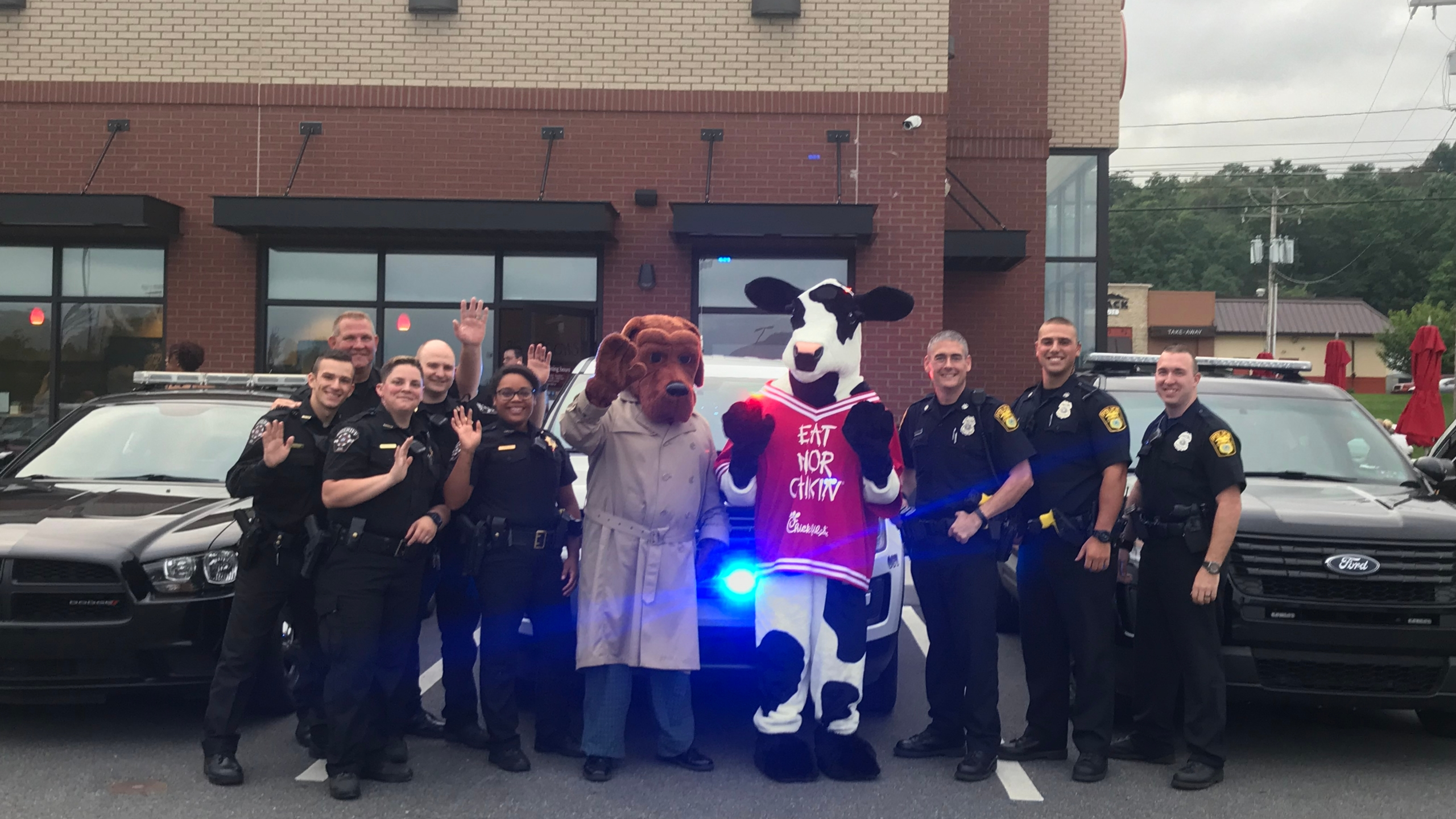 Local kids join law enforcement at Chick fil A_1534881730350.jpg.jpg