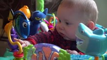baby with toys_1540936258871.jpg.jpg