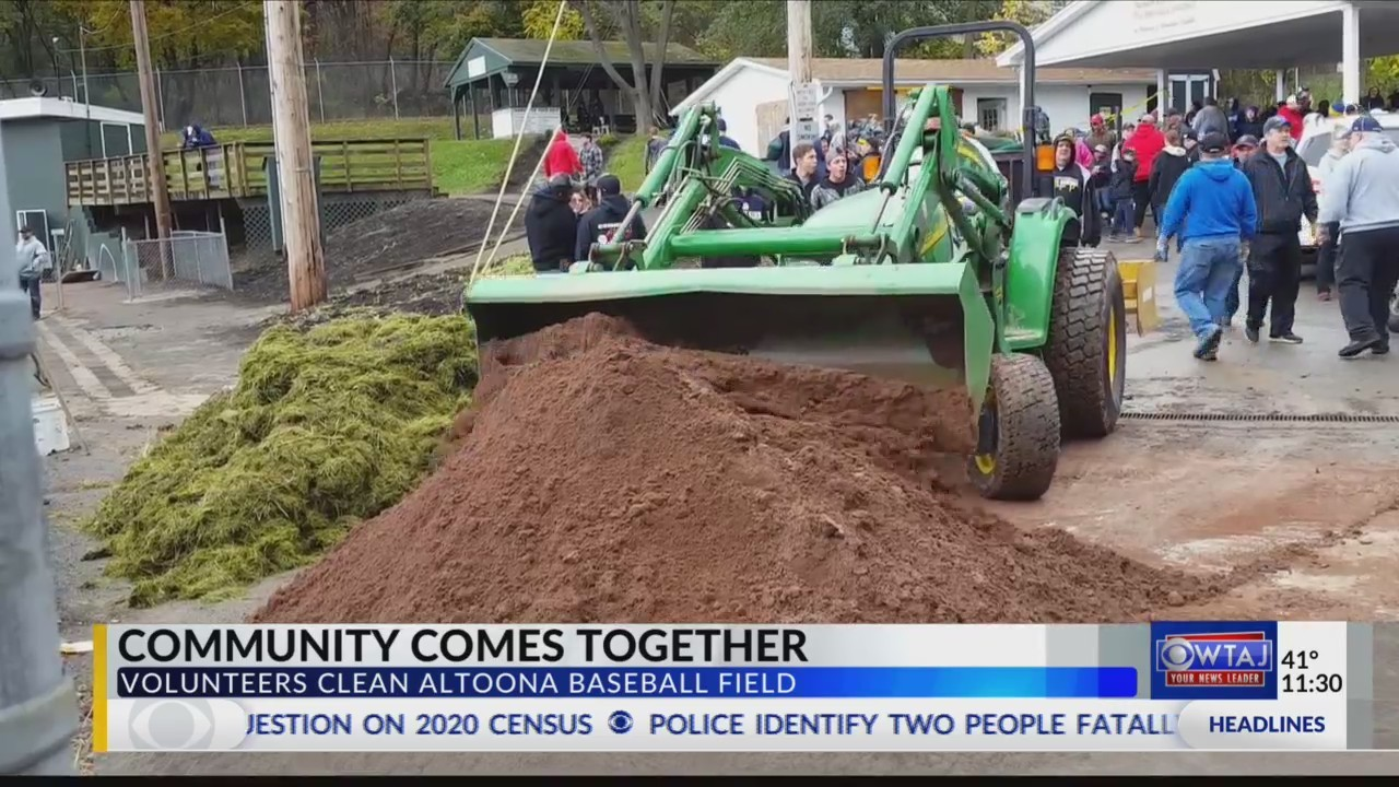 Volunteers clean up local ball park destroyed by vandals.