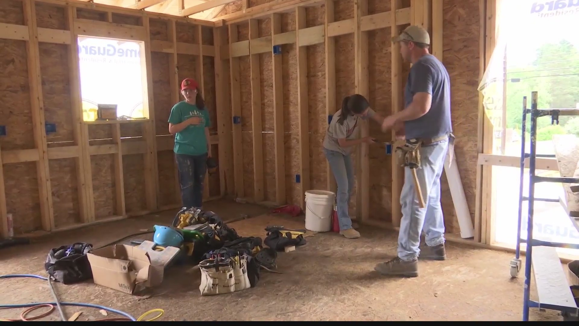 Volunteers help build house for family in need