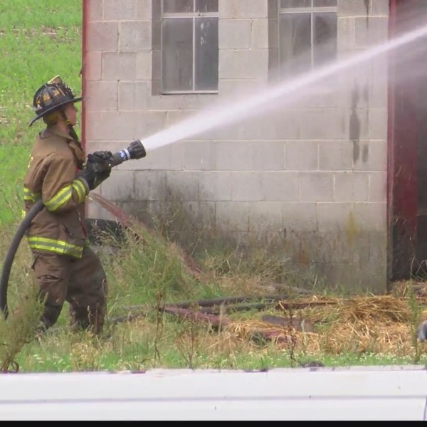 Officials: Old hay almost starts fire at barn