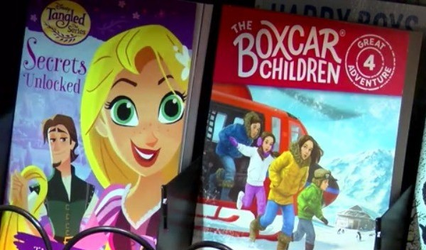 """A copy of """"secrets unlocked"""" and """"the boxcar children"""" inside of a vending machine"""